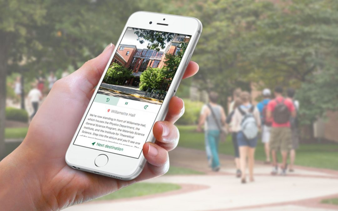 discover pathwaze student holding phone on virtual campus tour